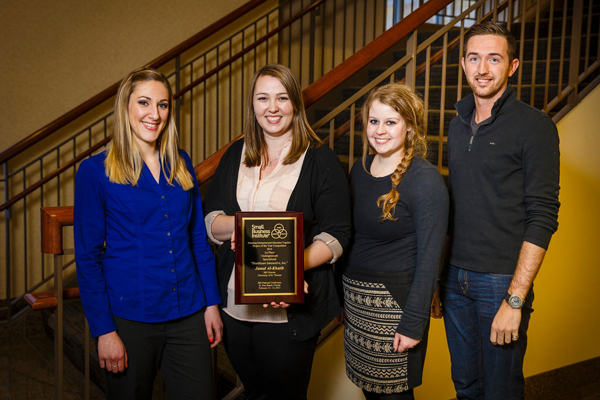 St. Thomas Opus College of Business undergraduate students pose with their first place plaque from the national Small Business Institute competition February 23, 2015 in McNeely Hall.