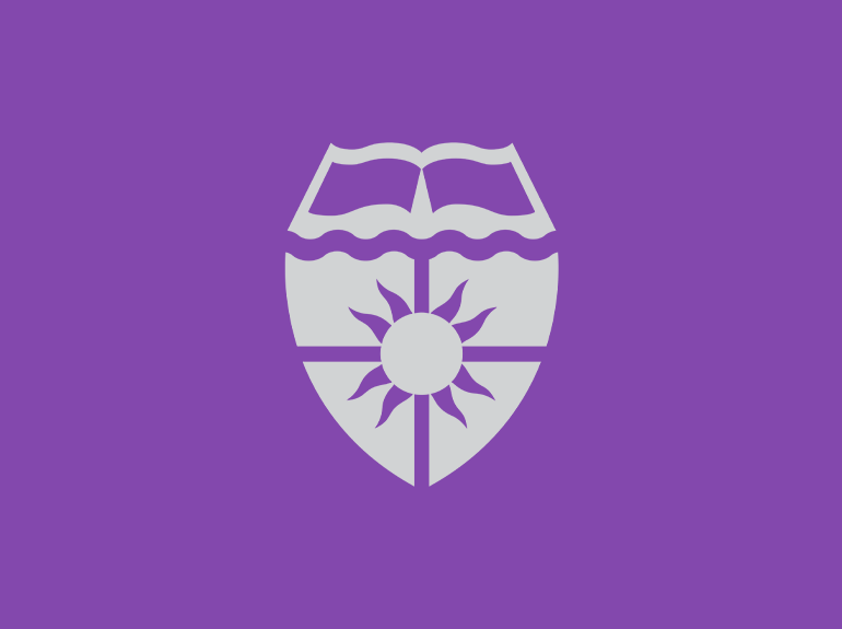 University of St. Thomas shield.