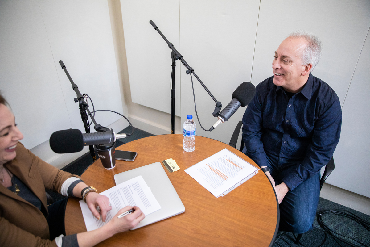 Opus faculty member Gino Giovanelli recording a podcast with Twin Cities Business