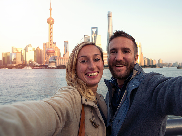 Two students in front of Shanghai skyline