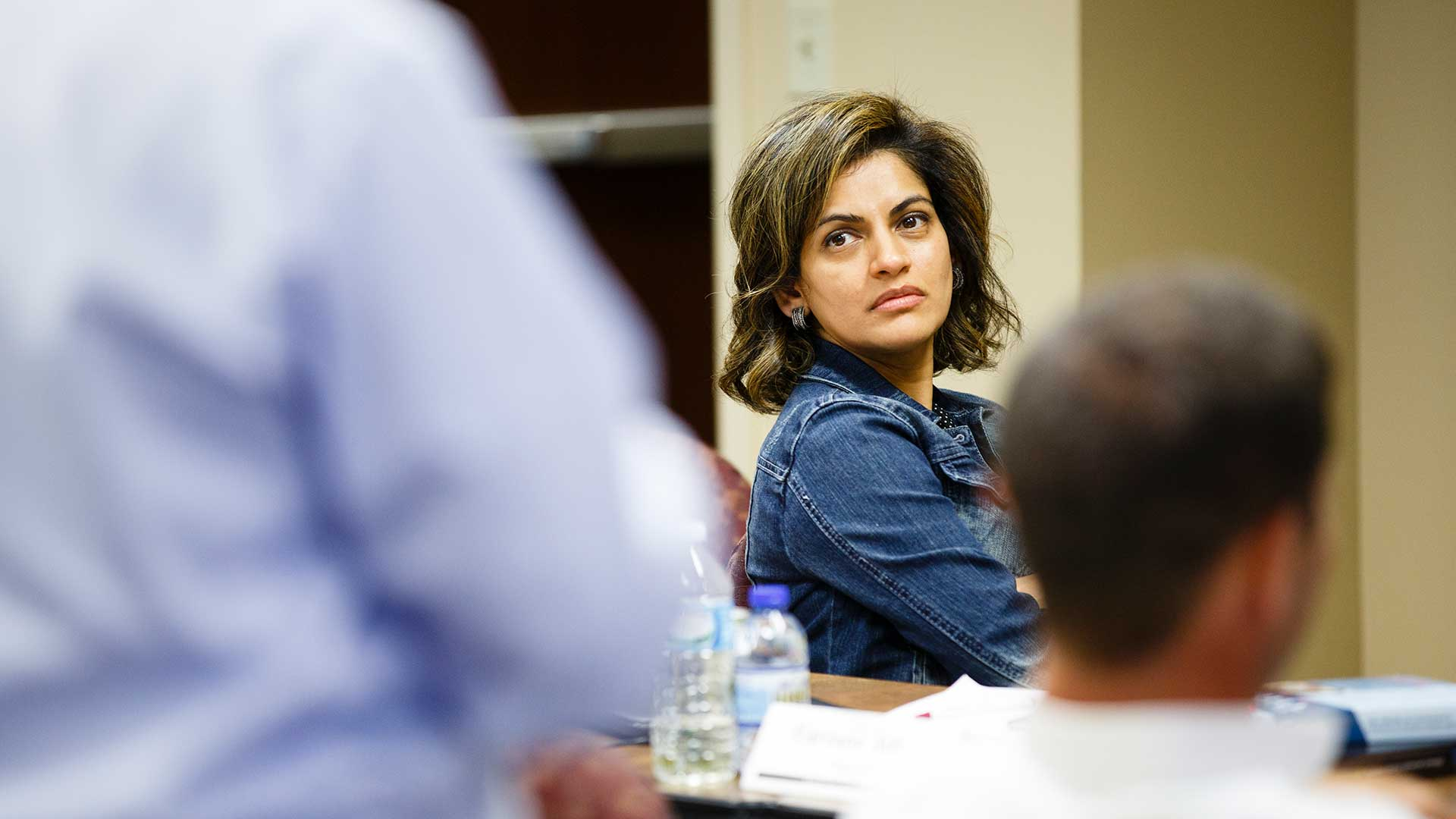 A student listens to an instructor during an Operations for Executives class.