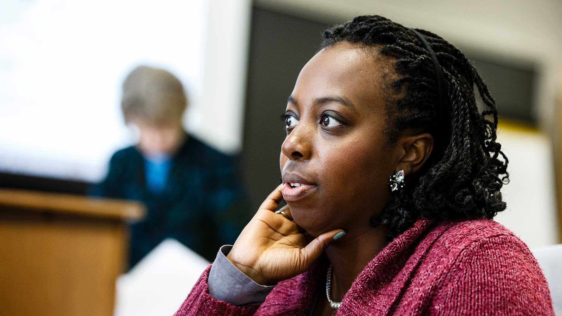 A student participates in a discussion during a class.