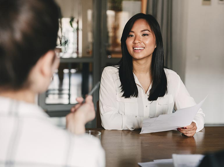 Business woman talking during job interview.