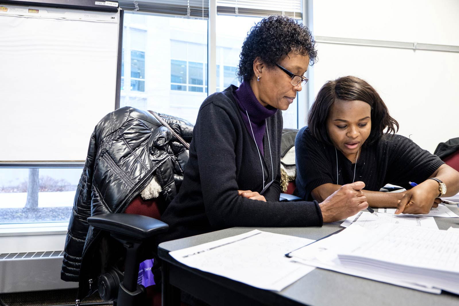 Students work together on an assignment during an Opus business class in Terence Murphy Hall.