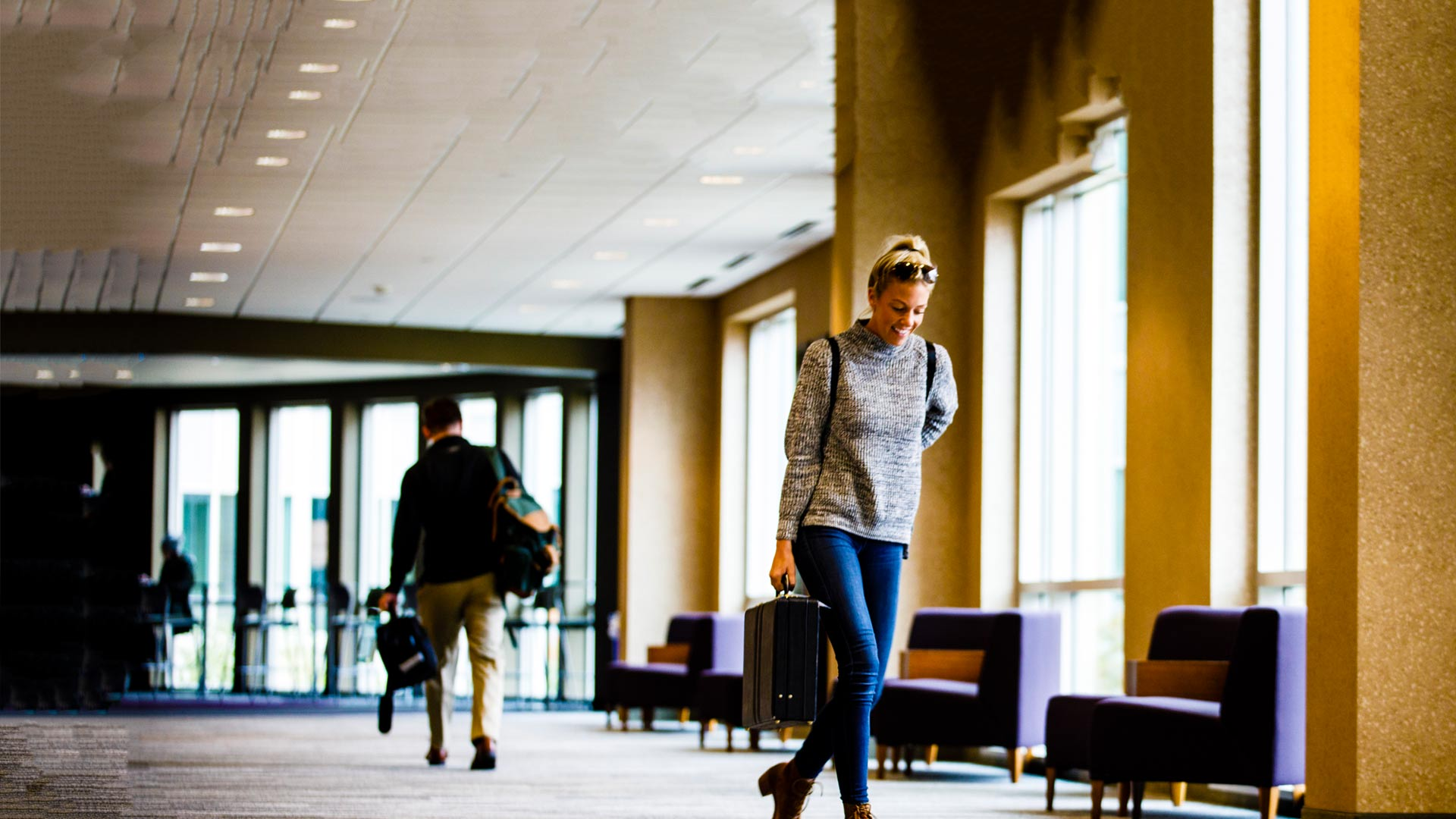 A student walks through the skyway connecting Schulze Hall with Terrence Murphy Hall