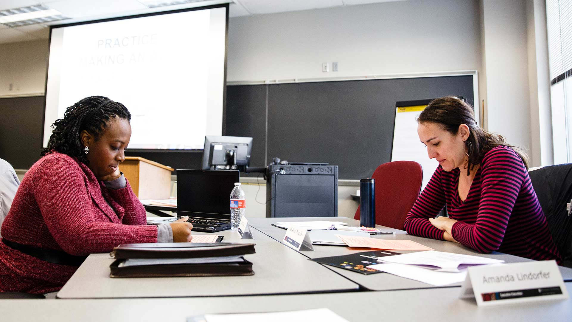 Students work on a project during a class in the Executive Education program in the Opus College of Business in Terrence Murphy Hall in Minneapolis on February 26, 2016.