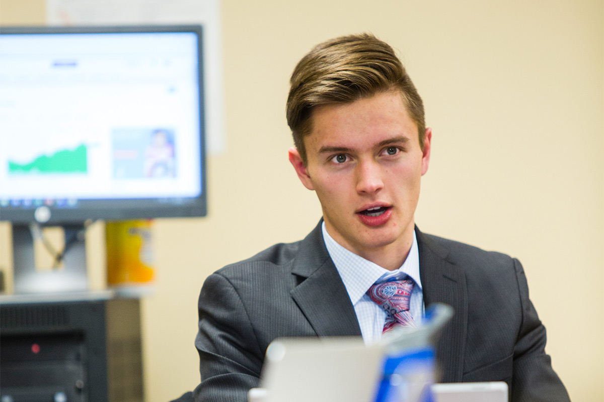 A student of the Aristotle Fund Class participates in a weekly fund update discussion