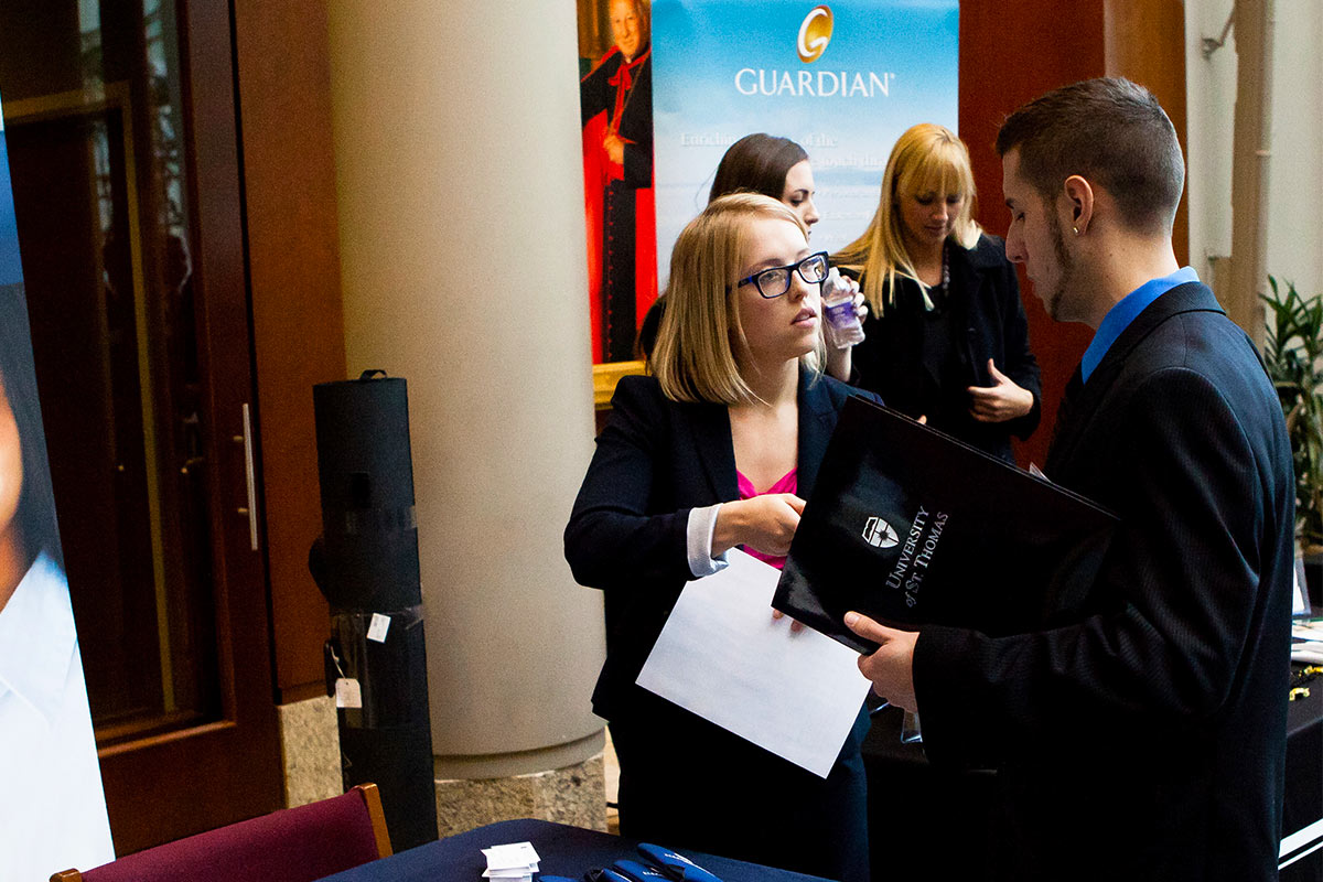 Students engage with employers at the a career fair.