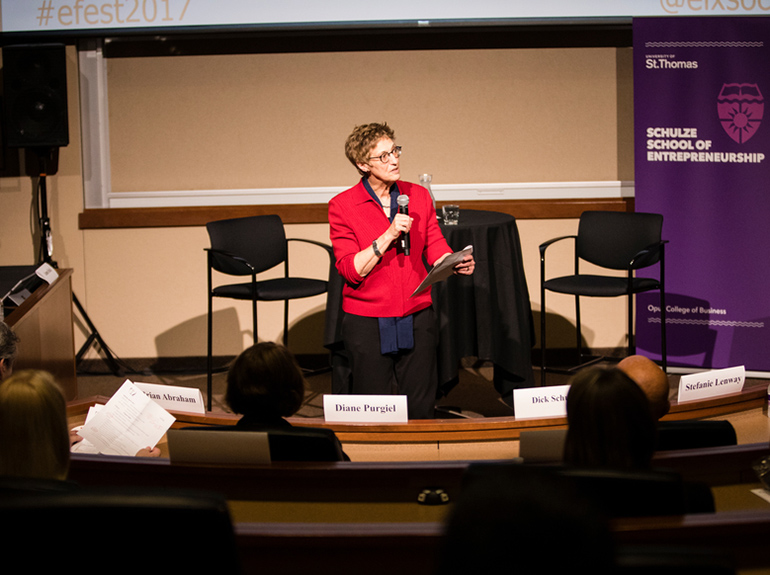 Opus College of Business Dean Stefanie Lenway gives opening remarks in Schulze Auditorium in Schulze Hall.