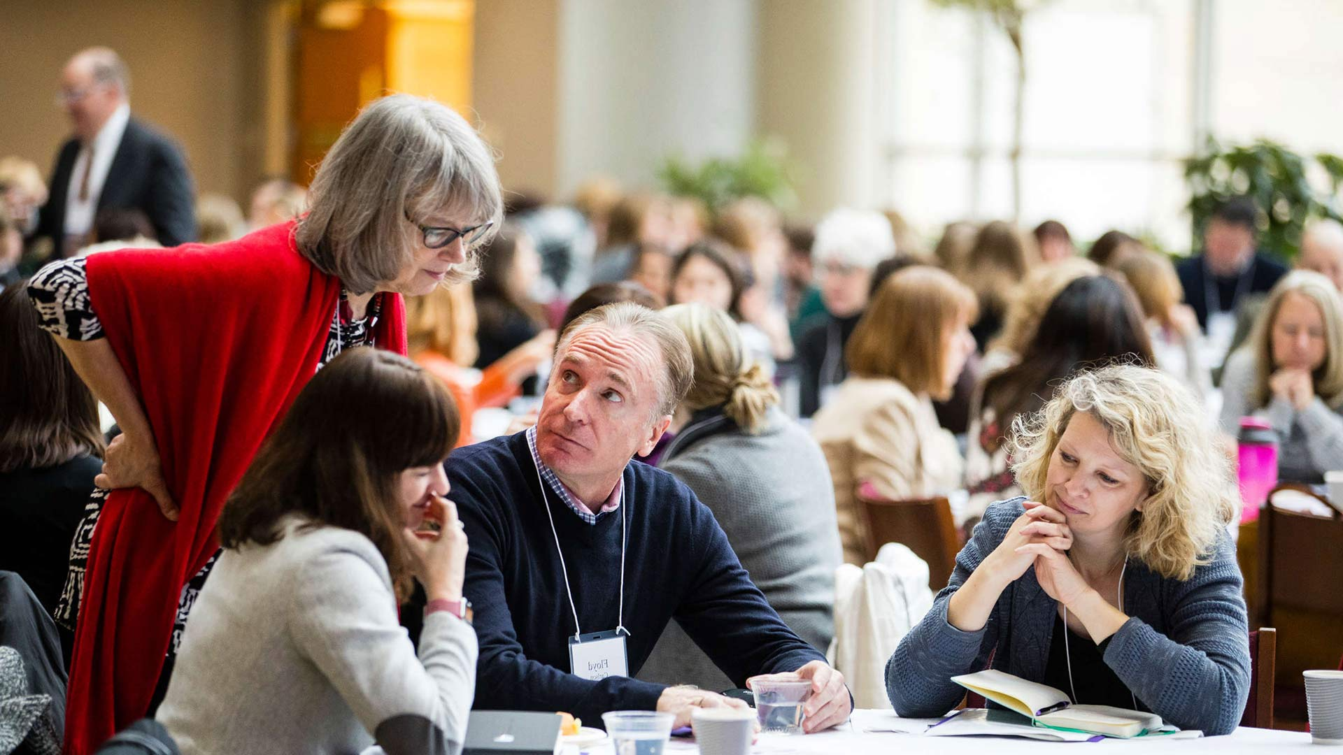 Attendees work on a group exercise during the Executive Coaching in Organizations Conference in the Schulze Grand Atrium in the School of Law building in Minneapolis on January 19, 2018.