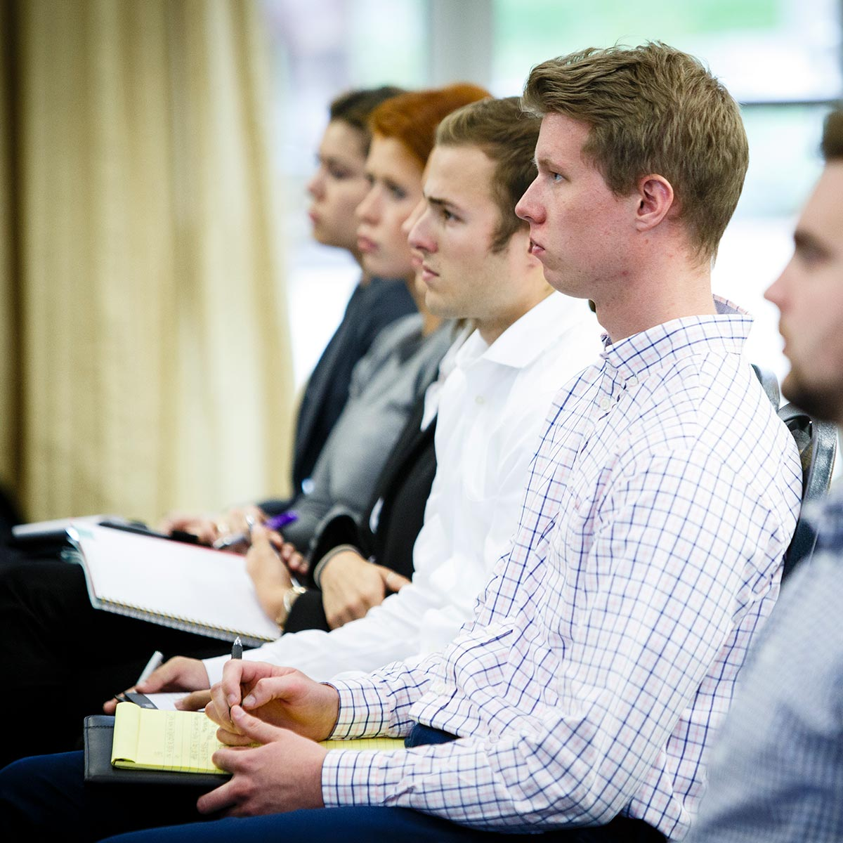 Students pay attention during an employer information session.