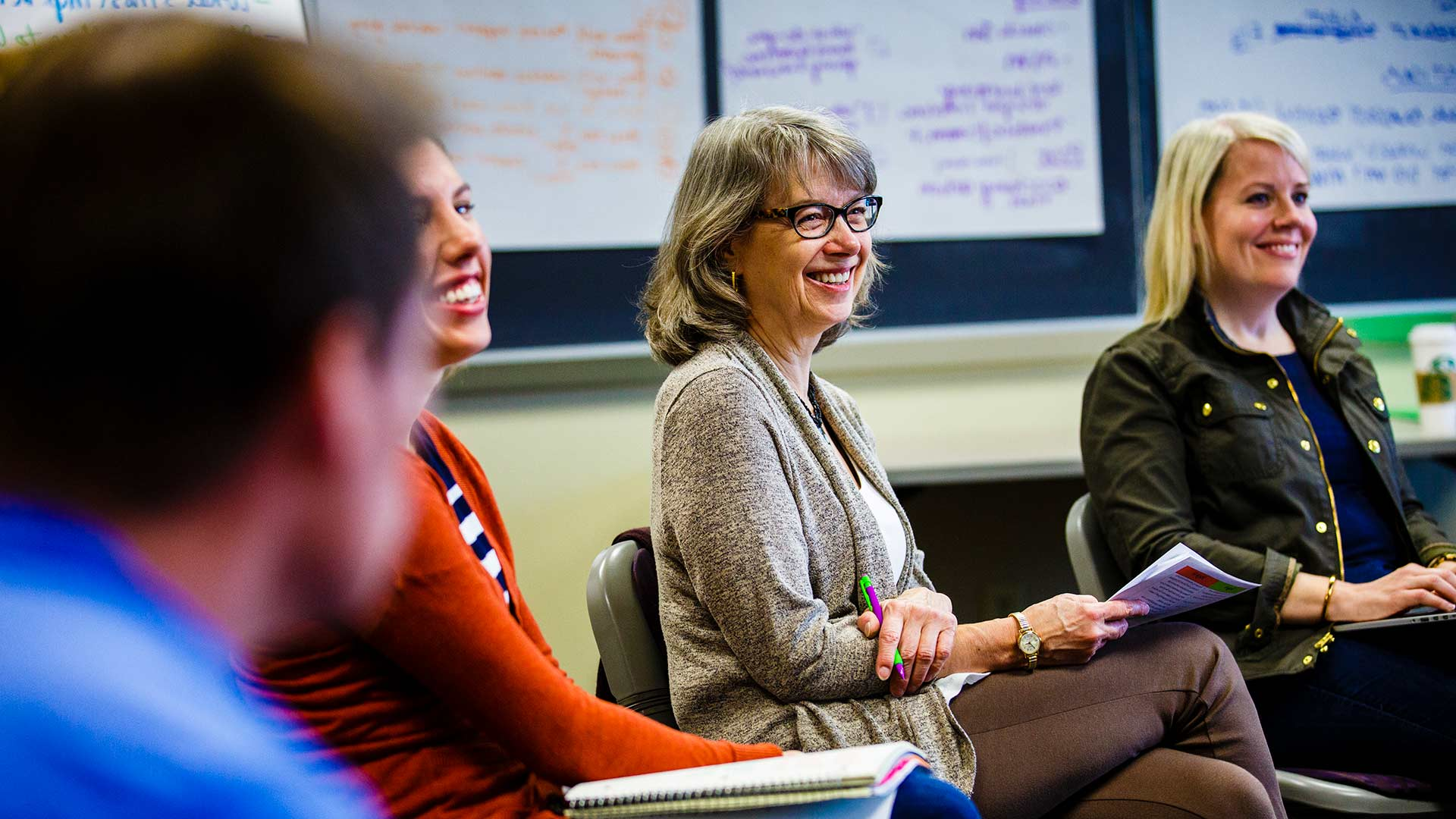 Instructor Bev Lutz laughs during an executive class in Opus Hall.