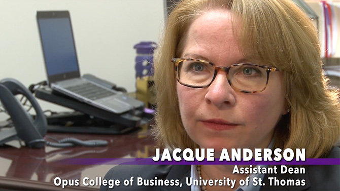 "Closeup on woman, tagline says ""Jacque Anderson, Assistant Dean of the University of St. Thomas' Opus College of Business"""