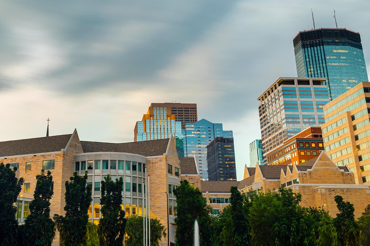 A view of Schulze Hall and the skyline behind in downtown Minneapolis.