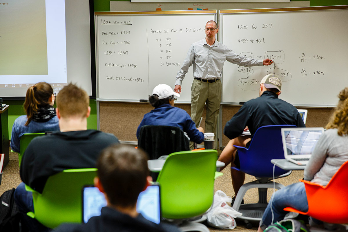 Professor Jay Ebben teaching in a classroom.