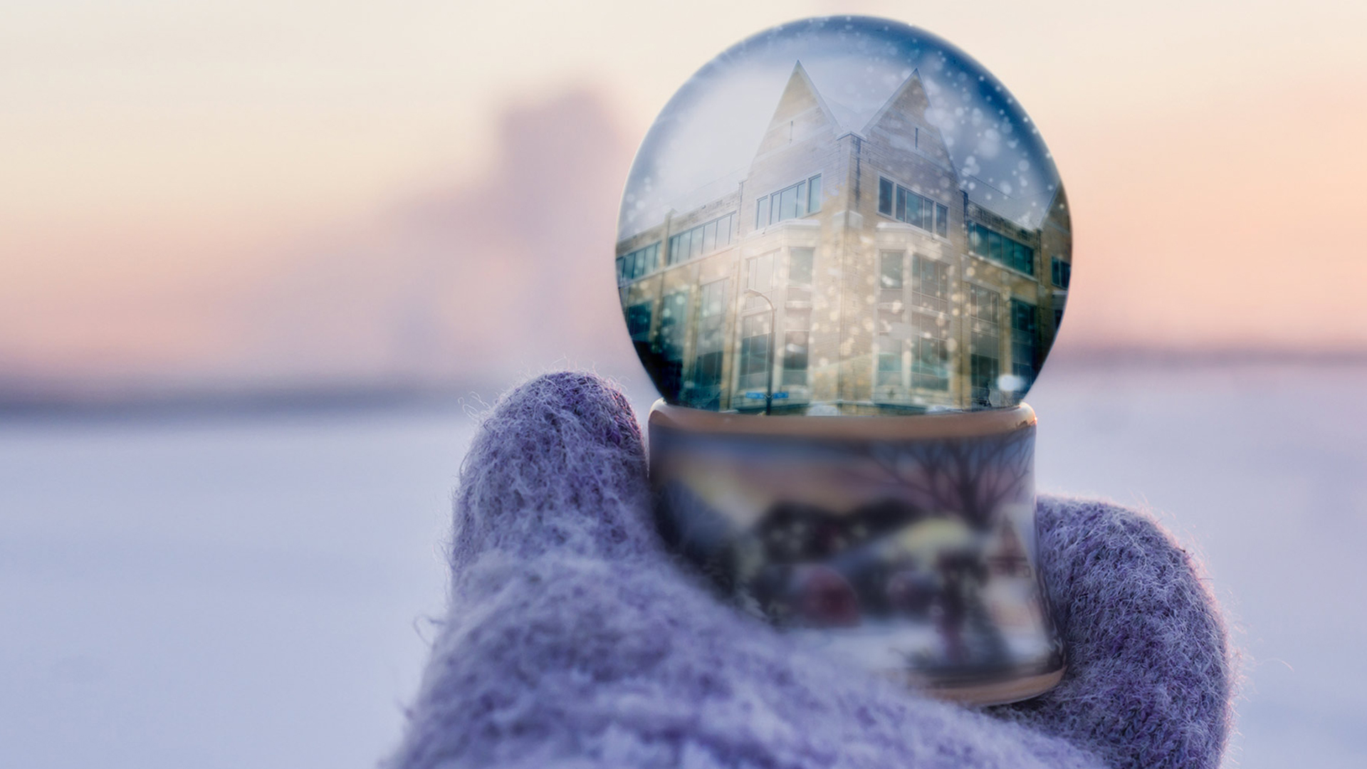 A snow globe reflecting the University of St. Thomas