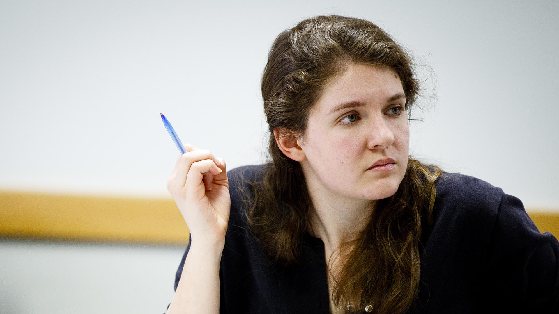 Student listens to a discussion during a Shakespeare class in the John Roach Center for the Liberal Arts.