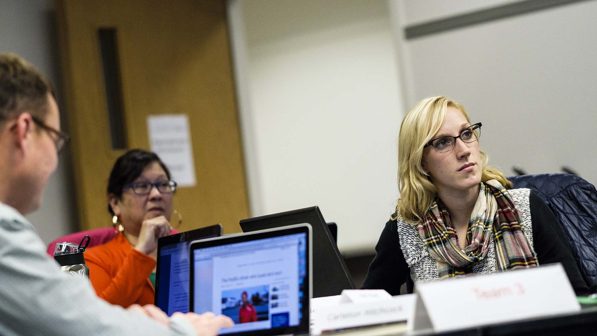 Students listen to a lecture during an Executive Education Class in Terence Murphy Hall.