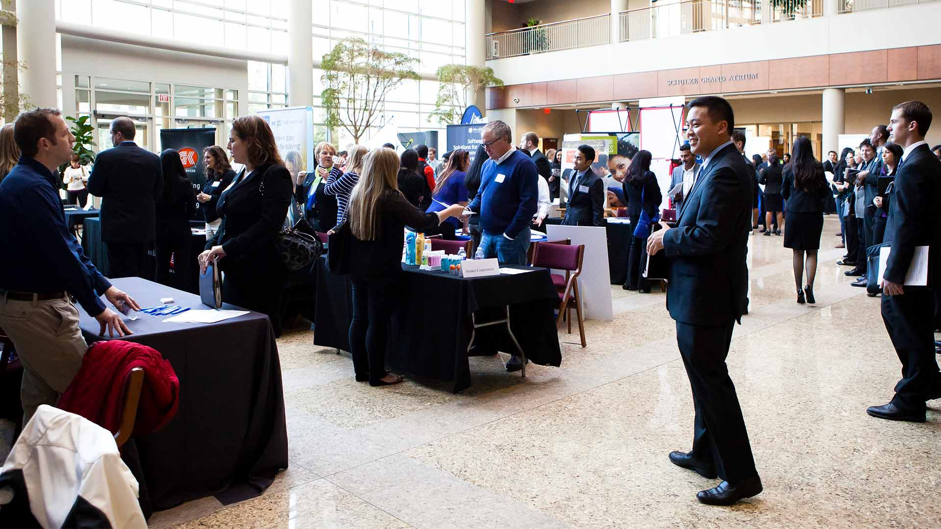 Students engage with employers at a career fair.