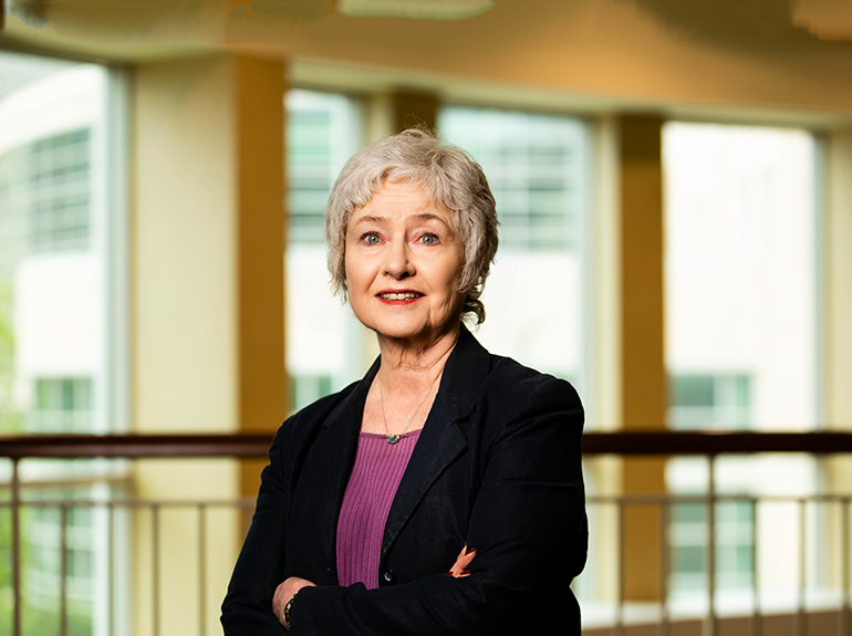 Assistant Dean of the undergraduate business program Georgia Fisher posing for a headshot.