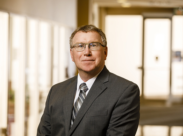 Senior Associate Dean in the Opus College of Business Michael J. Garrison posing for a headshot.