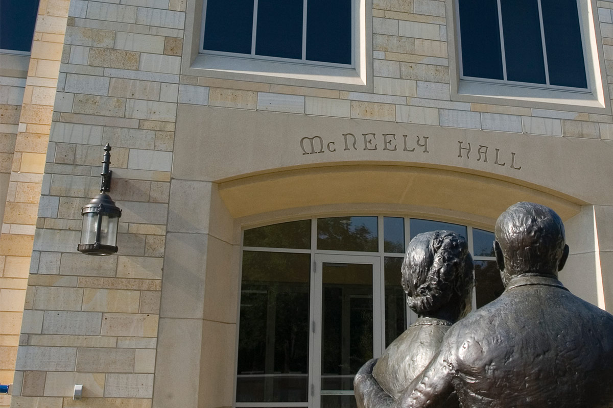 McNeely Hall exteriors with sculpture in front of building.
